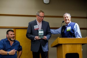 Tom Minty and Barry presenting best practices award to Northwest Multiple Listing Service